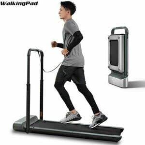 Man Running on walkingpad R1 Pro with a folded treadmill besides