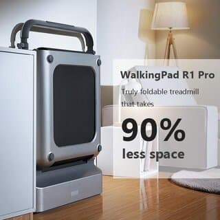 Foldable Treadmill stowed at the side of a room with furniture around it