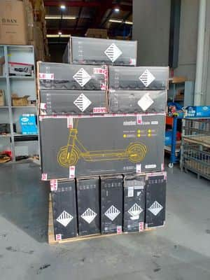 a pallet full of refurbished segway ninebot max is placed in the warehouse